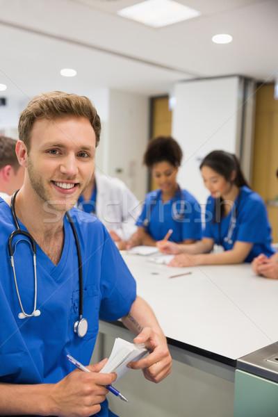 Orvostanhallgató mosolyog kamera osztály egyetem férfi Stock fotó © wavebreak_media
