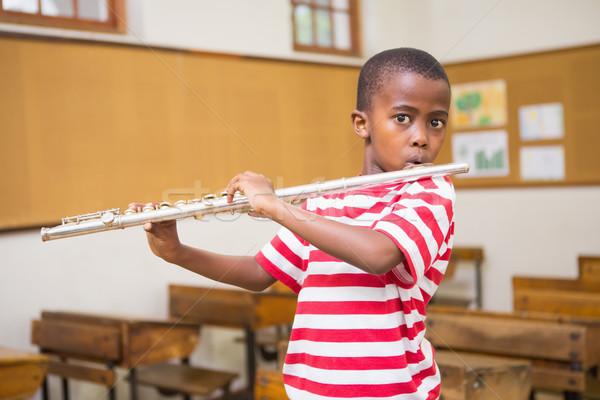 Cute giocare flauto classe scuola Foto d'archivio © wavebreak_media