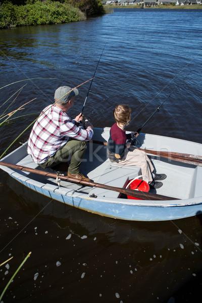 Feliz hombre pesca hijo barco primavera Foto stock © wavebreak_media