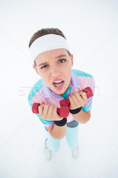 Hipster girl lifting dumbbells Stock photo © wavebreak_media