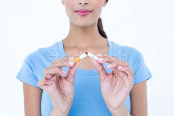 Stock photo: Pretty woman breaking a cigarette