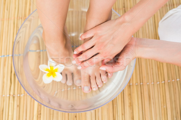 woman washing her feet in a bowl of flower Stock photo © wavebreak_media