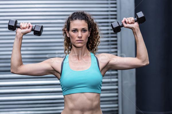 мышечный женщину весов crossfit спортзал Сток-фото © wavebreak_media