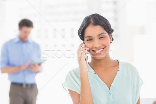 Stock photo: Casual colleagues using digital tablet and telephone