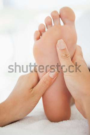 Close-up of a woman receiving foot massage Stock photo © wavebreak_media