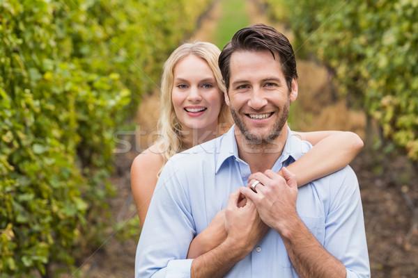 Fiatal boldog pár átkarol egyéb szőlő Stock fotó © wavebreak_media