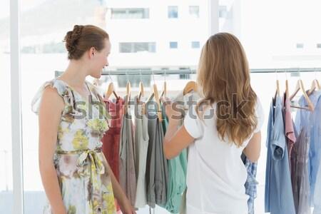 Sorrindo vestir namorado roupa armazenar Foto stock © wavebreak_media