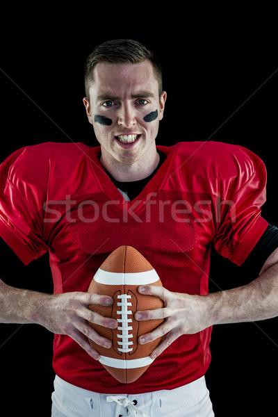 Amerikai futballista tart labda portré határozott Stock fotó © wavebreak_media