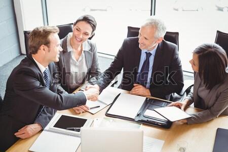 Widoku biznesmenów drżenie rąk sala konferencyjna biuro Zdjęcia stock © wavebreak_media