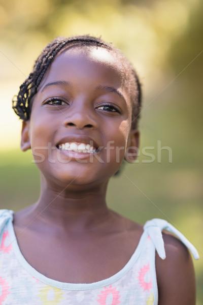 Portrait of smiling girl standing in forest Stock photo © wavebreak_media