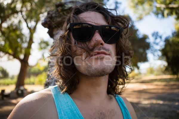 Man in sunglasses at a park Stock photo © wavebreak_media