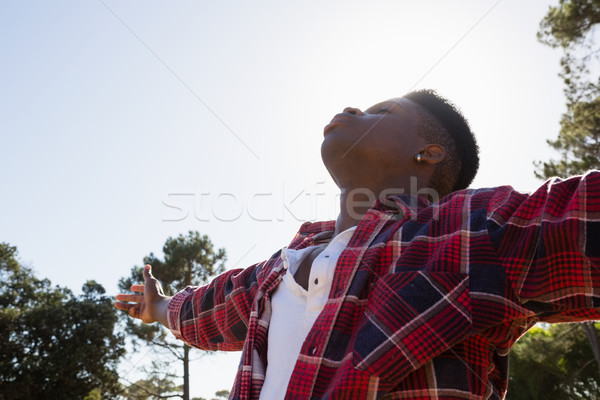 Stock photo: Man standing with arms outstretched in the park