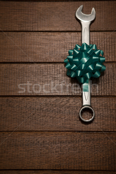 Ribbon with wrench on wooden table Stock photo © wavebreak_media