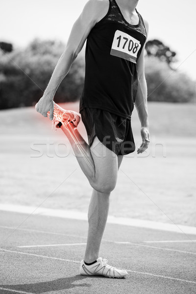 Highlighted bones of athlete man stretching on race track Stock photo © wavebreak_media