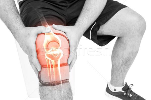 Uomo sofferenza ginocchio dolore bianco digitalmente Foto d'archivio © wavebreak_media