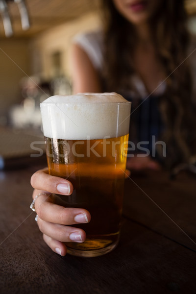 Close-up of barmaid holding beer glass Stock photo © wavebreak_media