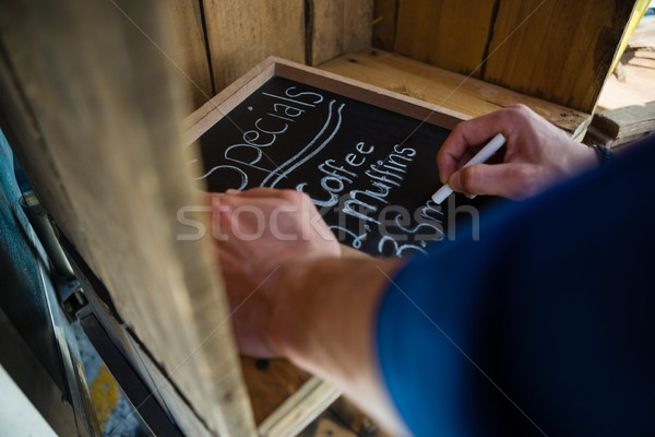 Cropped hand of owner writing menu in food truck Stock photo © wavebreak_media