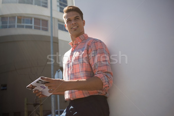 Man looking away while standing by wall Stock photo © wavebreak_media