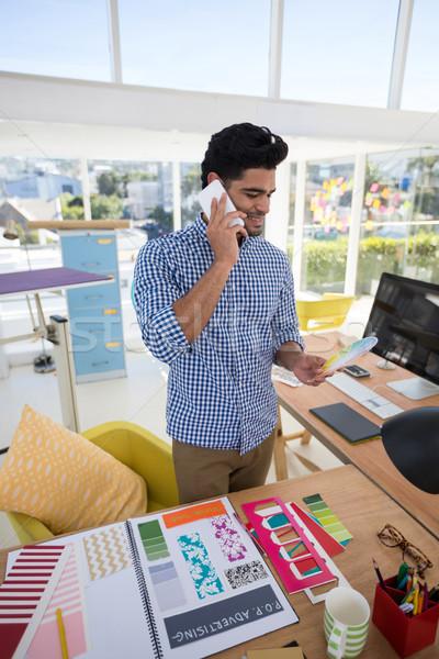 Male graphic designer talking on mobile phone at desk Stock photo © wavebreak_media