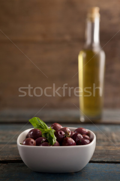 Black olive in container with bottle in background Stock photo © wavebreak_media