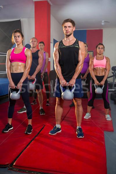 Csoport fiatal sportolók emel fitnessz stúdió Stock fotó © wavebreak_media