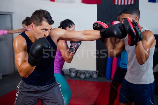 Férfi boxoló oktató gyakorol box fitnessz Stock fotó © wavebreak_media