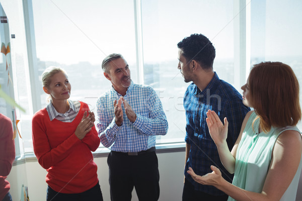 Stock photo: Business entrepreneurs discussing by window at office