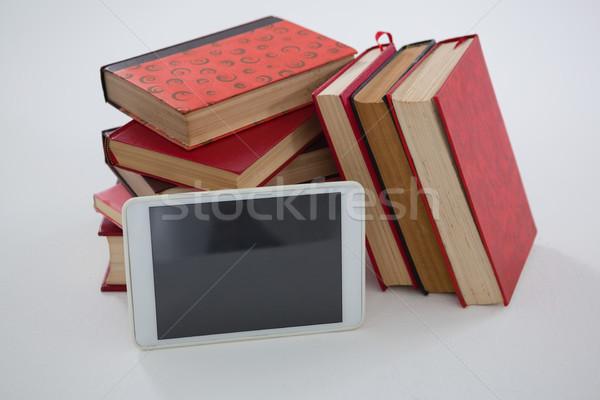 Books and digital tablet arranged on white background Stock photo © wavebreak_media