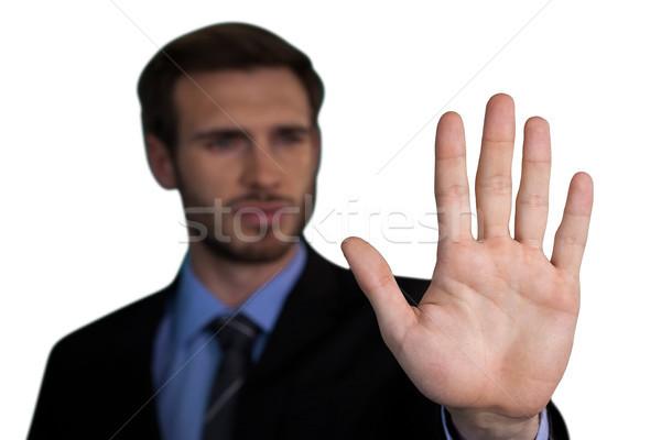 Imprenditore toccare Palm invisibile interfaccia Foto d'archivio © wavebreak_media