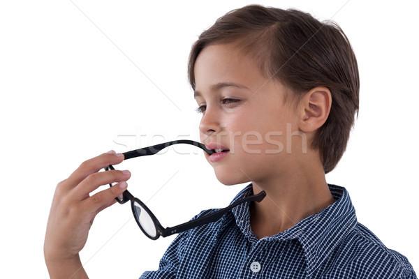 Ragazzo occhiali bambino parlando Foto d'archivio © wavebreak_media