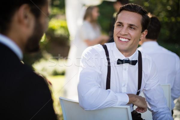 Waiter interacting with man in park Stock photo © wavebreak_media