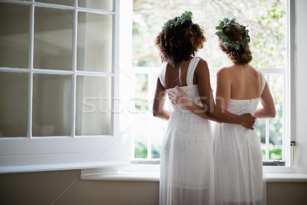 Achteraanzicht vrouwen permanente venster home liefde Stockfoto © wavebreak_media