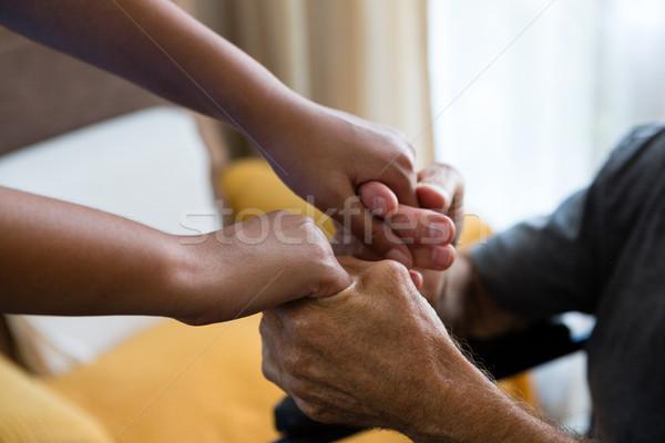 женщины врач старший человека , держась за руки дом престарелых Сток-фото © wavebreak_media