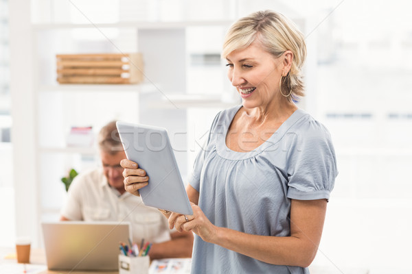 Smiling businesswoman scrolling on a tablet Stock photo © wavebreak_media