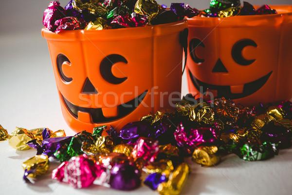 Close up of orange buckets with multicolored chocolates Stock photo © wavebreak_media