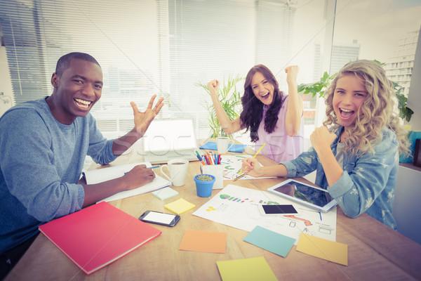 Retrato sorridente pessoas de negócios sessão secretária Foto stock © wavebreak_media