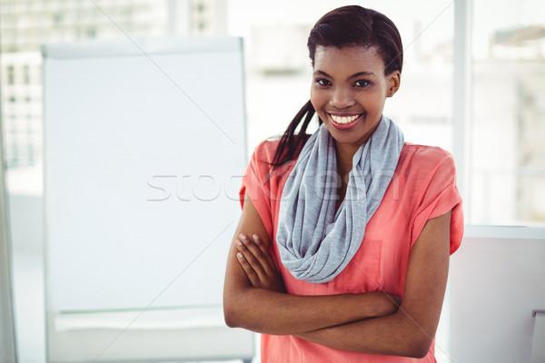 Smiling creative businesswoman by her desk Stock photo © wavebreak_media