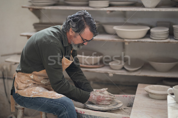 Male potter molding a clay Stock photo © wavebreak_media