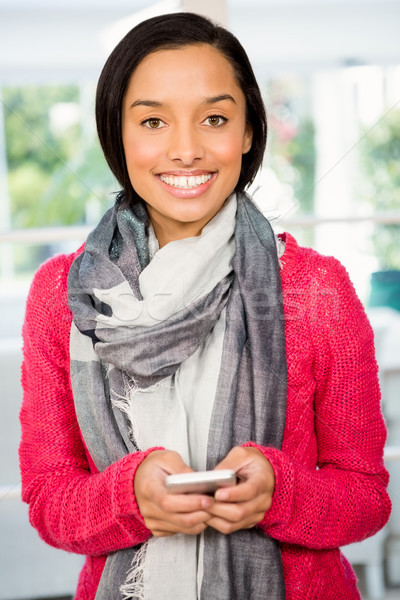 Smiling brunette using smartphone Stock photo © wavebreak_media