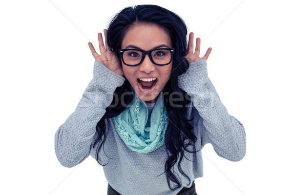 Asian woman shouting to the camera Stock photo © wavebreak_media