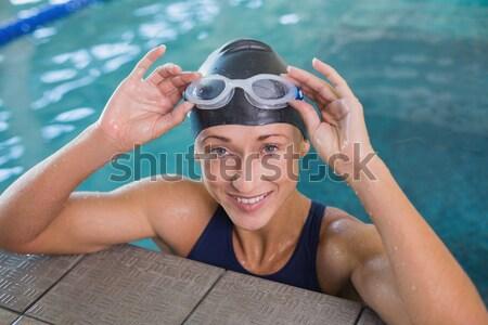 Handsome man wearing swim cap and goggles Stock photo © wavebreak_media