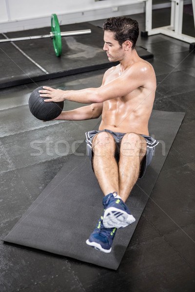 Shirtless man exercising with medicine ball Stock photo © wavebreak_media