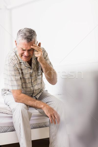 Suffering senior man touching his forehead Stock photo © wavebreak_media