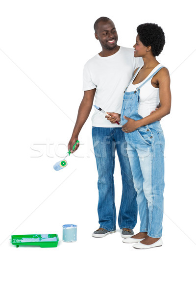 Pregnant couple with blue paint tin Stock photo © wavebreak_media