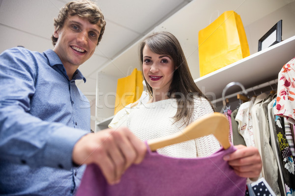 Portrait of couple selecting a dress while shopping for clothes Stock photo © wavebreak_media
