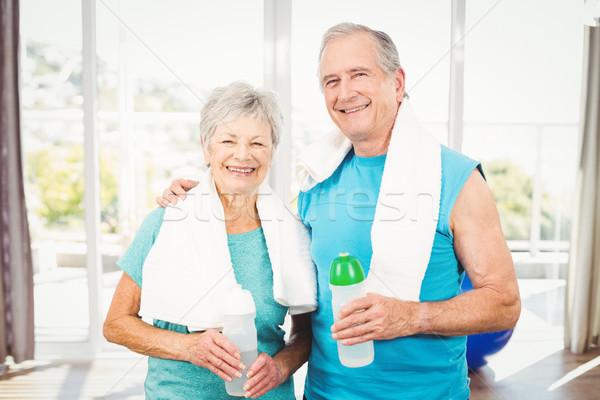 Portrait of smiling senior couple holding bottle Stock photo © wavebreak_media