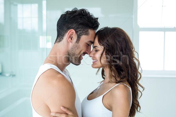 Fiatal romantikus pár áll szemtől szembe közelkép Stock fotó © wavebreak_media