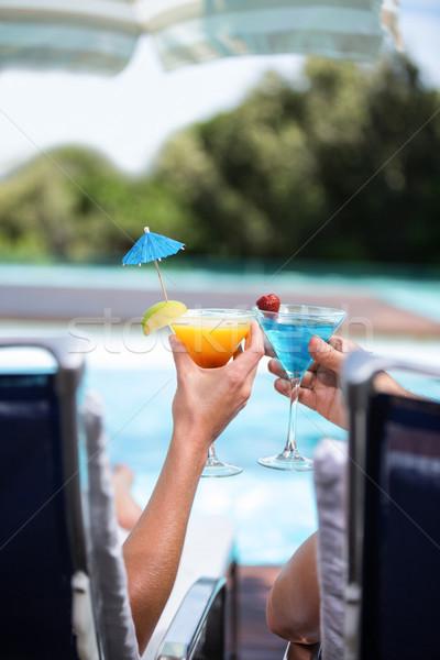 Kezek pár pirít martinis pohár medence nő Stock fotó © wavebreak_media