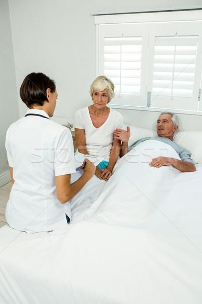 Female caregiver with senior couple at home Stock photo © wavebreak_media