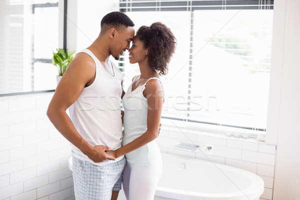 Young couple embracing each other in bathroom Stock photo © wavebreak_media